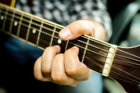 fingering: Acoustic guitar being played, Fingers holding a chord