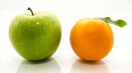 apple and orange: Apples and oranges fresh from the garden isolated white background.