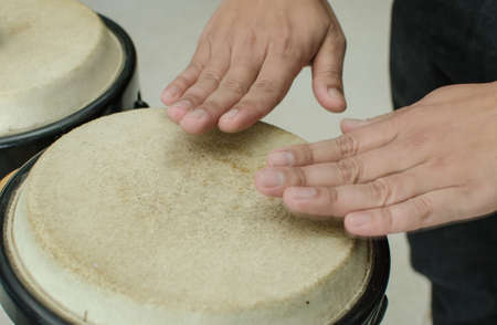thump: Close up of a hands beating a drum