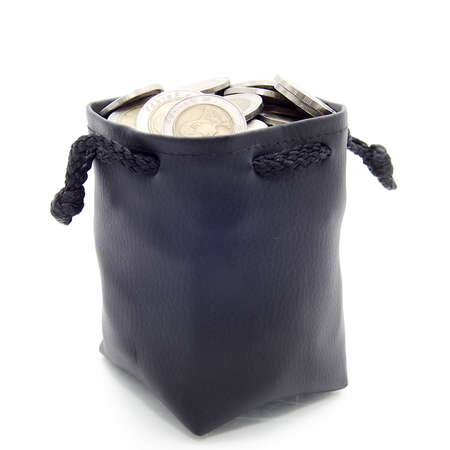 change purse: studio photography of a open leather moneybag filled with coins seen from above in white back