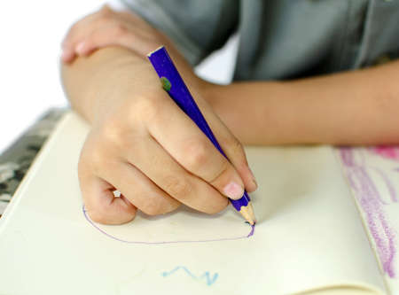 Cute little schoolboy drawing isolate on white background photo
