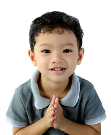 A kid is asking for permission; isolated on the white background Stock Photo