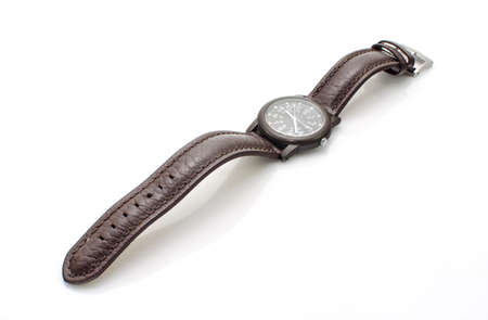 Old wristwatch with leather strap  isolate on white background photo