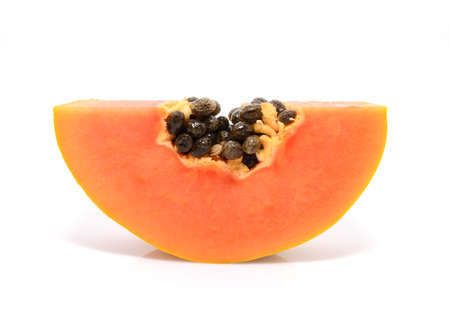 Half cut and whole papaya fruits on white background