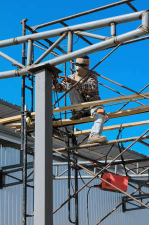 hight: Workers welding steel structures with hight area