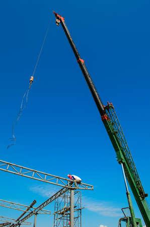 maneuverable: auto crane on construction site Stock Photo