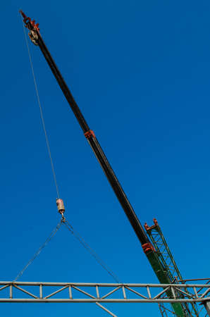 maneuverable: auto crane on construction site Stock Photo