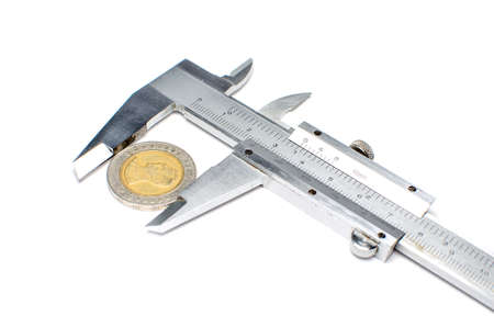 sliding caliper: vernier caliper measures the coins Stock Photo