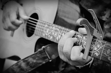 country music: Man playing guitar, Close up shot.