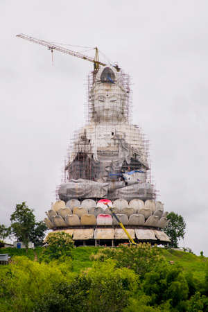 immortal: Guan Yin statue under construction, Wat huay pla kang , Chiang Rai, Thailand Stock Photo