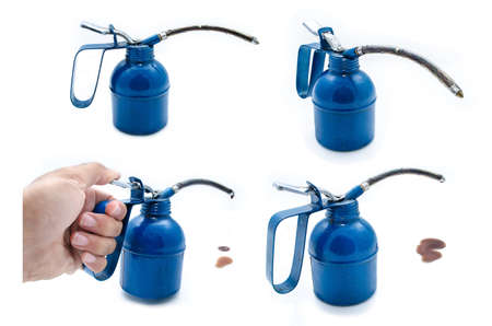lubricator: isolated old dark blue metal oil can Stock Photo