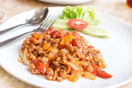 bolognaise: Italian spaghetti with a meat based bolognese, or bolognaise, sauce on a plain white plate