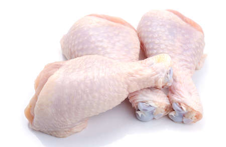 Chicken legs on white background Imagens