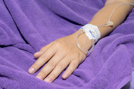 Close up of patient in hospital with saline intravenous photo