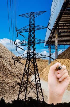 biomasa: Drenaje de la mano de la energía a partir de biomasa de la comunidad. Foto de archivo