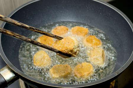 Crispy Prawn Rolls or Deep fried shrimp rolled in Black pan photo