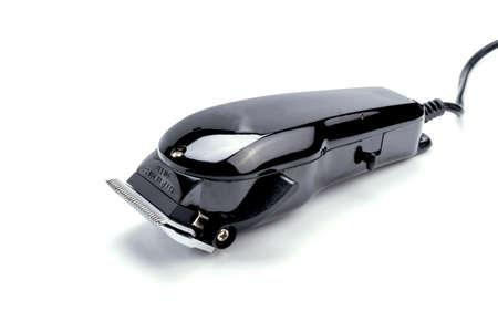 shorten: maquinilla el�ctrica en el fondo blanco. Foto de archivo