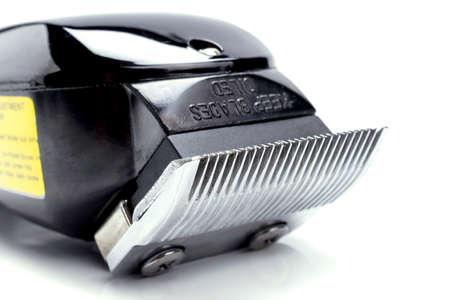 shorten: electric clipper on white background. Foto de archivo