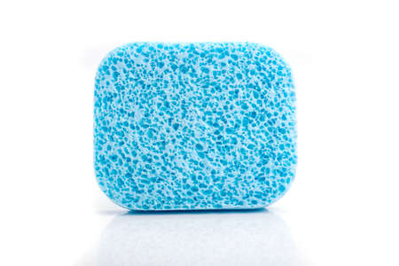 A super absorbent cellulose blue sponge on white. photo