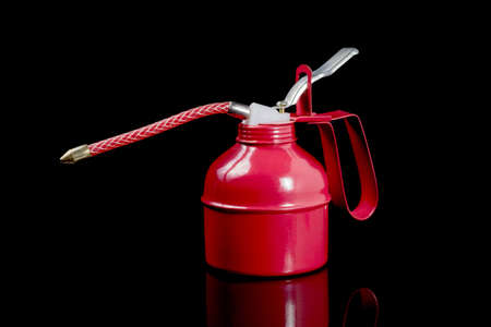 lubricate: Brand new oil can  on black background Stock Photo