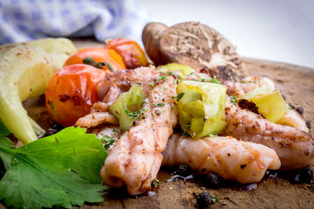 nostalgy: grilled squids on wood board. Stock Photo