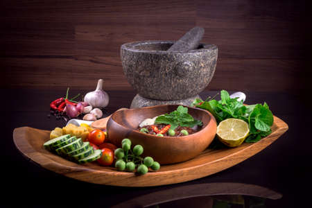 cuisine: Thai cuisine nam prik or chili paste mixes with fish serves with various vegetables Stock Photo