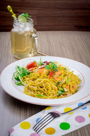 Pan fried noodle with crab stick. photo