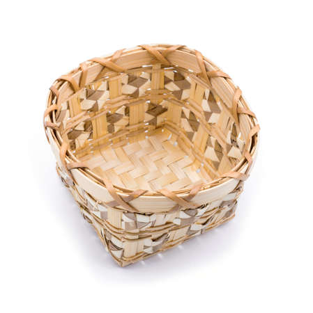Wooden wicker basket over white background photo