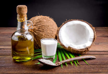 Coconut milk and coconut oil on wooden table
