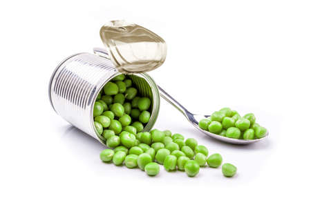 tinned goods: Opened tin with green peas. Isolated on white. Stock Photo
