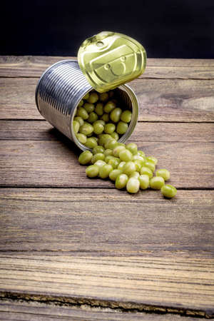canned peas: Canned Peas on vintage wooden background