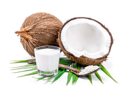 coconuts and coconut milk on white background. Imagens