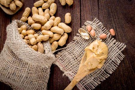 peanut: peanut butter and peanuts on the wooden floor