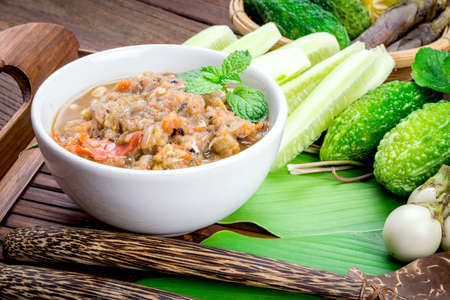 nam: Thai cuisine nam prik or chili paste mixes with fish serves with various vegetables Stock Photo