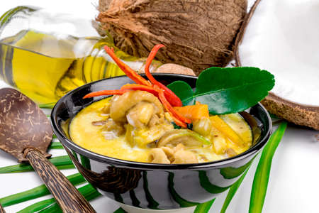 curry bowl: Hot coconut chicken soup with chili and curry In a bowl Stock Photo