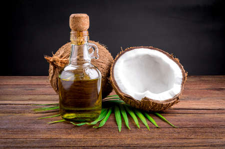 Coconut and coconut oil on wooden table Imagens - 40810146