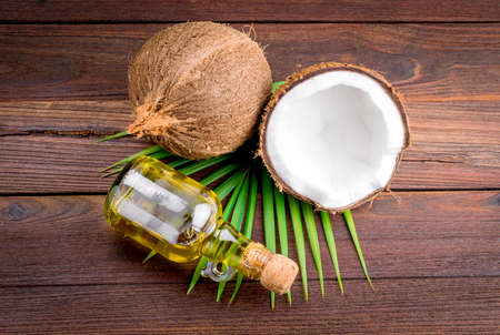 Coconut and coconut oil on wooden table