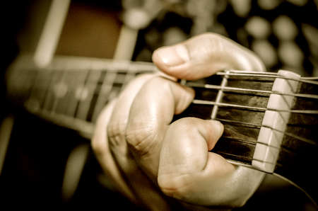 fingering: Acoustic guitar being played, Fingers holding a chord.(look soft)