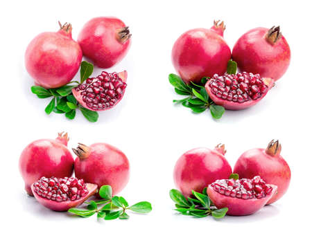 pomegranates: Ripe pomegranates with leaves isolated on a white background.