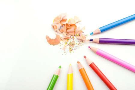wooden pencil: color pencils shavings on white background