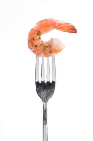 Shrimp Linguine on a fork, isolated on white background