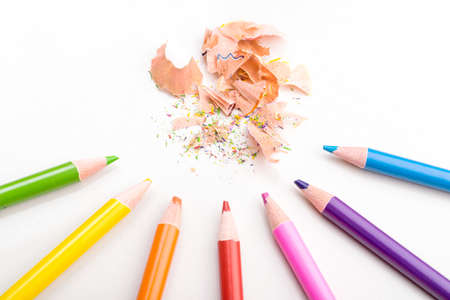 cuttings: color pencils shavings on white background