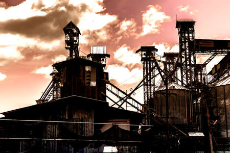 globalwarming: industry silhouettes as against a background of red sunset sky