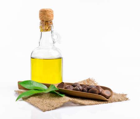 oil bottle: camellia oil on white background
