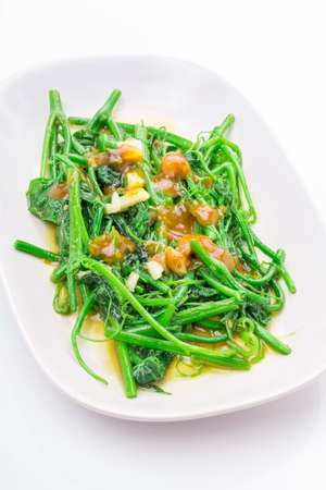 flavorsome: Stir-fried Chayote in dish on white background.