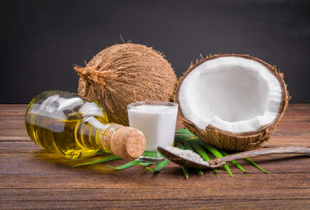 coconut fruit: Coconut milk and coconut oil on wooden table