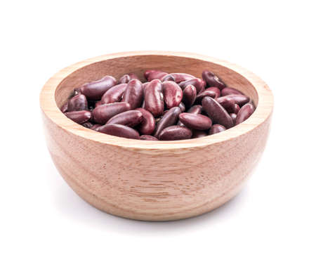 frijoles rojos: red beans in wood bowl on white background.