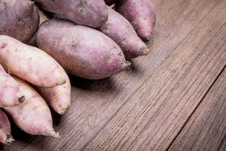 Sweet potatoes beautiful on a wooden table.