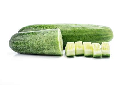 ripened: fresh and tasty green vine ripened garden grown cucumber on white background.