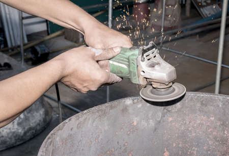 carelessness: Workers operate the grinder without protection.